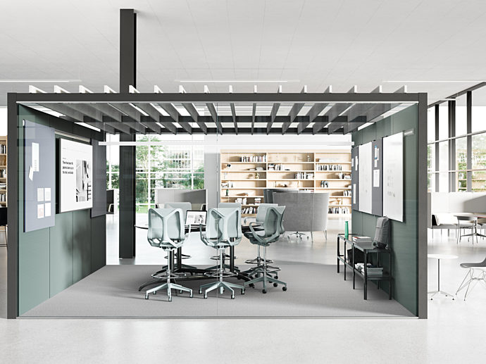 interior office meeting area inside a larger office space. high top meeting table inside the meeting space, with Herman Miller Cosm Stools