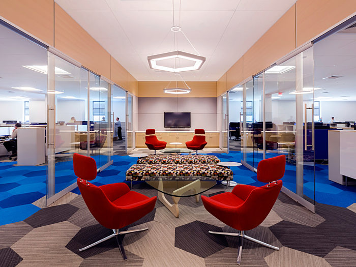 A corporate waiting area constructed using a prefabricated construction solution including glass walls, embedded technology & custom prefabricated ceiling